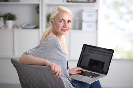Young beautiful woman using a laptop computer at home